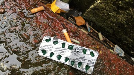 An empty drugs packet found in the back yard at Ridley Villas. Picture: Emma Youle