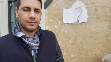 Alon Kubi with his bagel shop's smashed window, on Belsize Lane. Picture: Harry Taylor