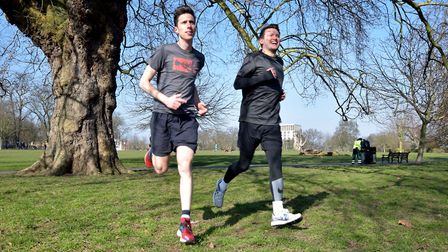 Sales manager Patrick Dunne (R) and Editor Ramzy Alwakeel get the blood pumping in Clissold Park. Pi
