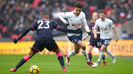 Huddersfield Town's Collin Quaner (left) is left for dead by Tottenham Hotspur's Dele Alli during th