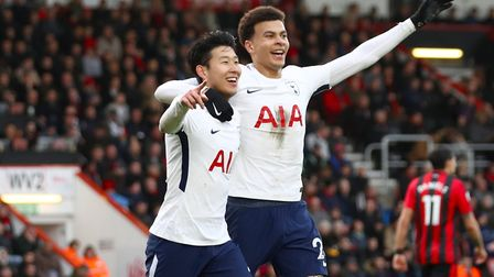 Tottenham Hotspur's Heung-min (left) Son celebrates with team-mate Dele Alli after scoring at AFC Bo