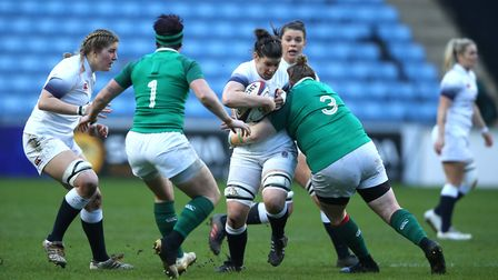 England Women's Sarah Hunter is tackled by Ireland Women's Leah Lyons (right) during the Natwest Wom