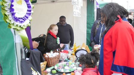 Ellie Hope selling goods on the Morningside and Gascoyne Youth Clubs stall. Picture: Ian Rathbone