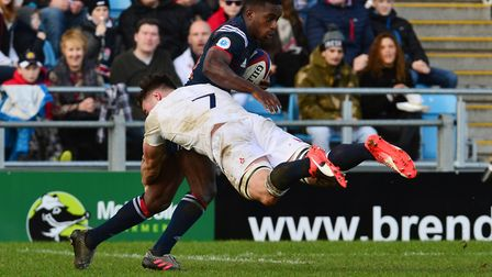 England's Ben Earl dives in to tackle a French rival (pic Ben Birchall/PA)