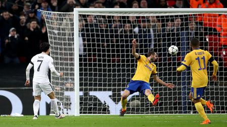 Tottenham Hotspur's Heung-min Son scores his side's first goal of the game against Juventus during t