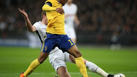 Juventus' Douglas Costa (left) is challenged by Tottenham Hotspur's Jan Vertonghen, but no penalty i