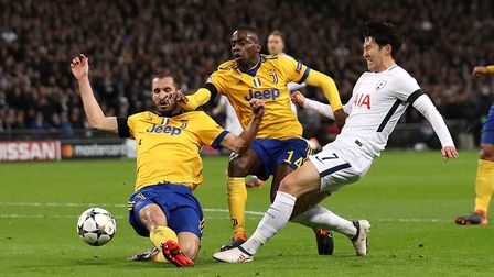 Tottenham Hotspur's Heung-min Son (right) battles with Juventus' Giorgio Chiellini (left) and Blaise