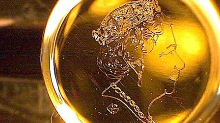 This is an engraving of the Queen on a pinhead. Picture: Graham Short