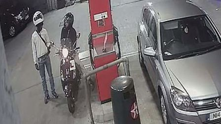 Derryck John and his accomplice at the Texaco garage in Mare Street, filling up with fuel during the