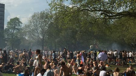 People enjoying the sunshine at London Fields after the Hackney Half in 2016. Picture: Gareth Jones