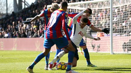 Tottenham Hotspur's Dele Alli appears to go down with pressure from Crystal Palace players during th
