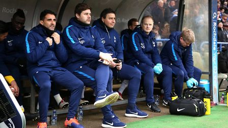 Tottenham Hotspur manager Mauricio Pochettino (second left) and his backroom staff on the bench befo