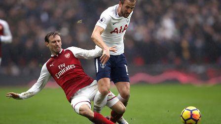 Arsenal's Nacho Monreal (left) and Tottenham Hotspur's Harry Kane battle for the ball during the Pre