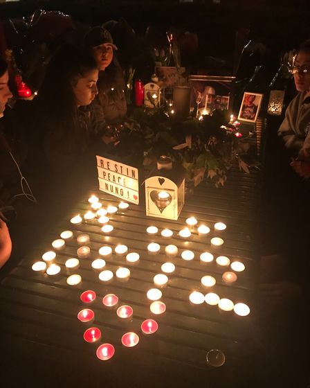 Friends and family held a vigil for Dotz on the Peckwater Estate.