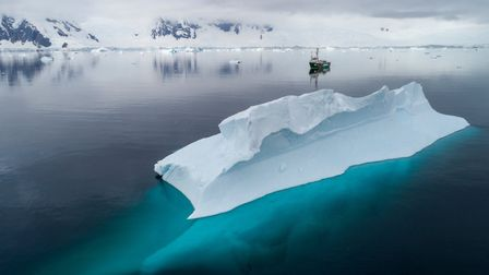 The Arctic Sunrise in Charlotte Bay, Antarctic Peninsula. Picture: Christian Aslund/Greenpeace