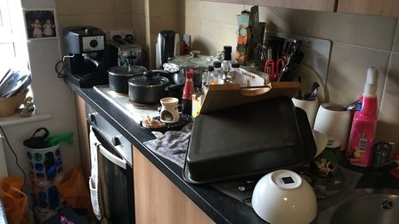 The cramped kitchen area is piled up with pots and pans. Picture: Emma Youle