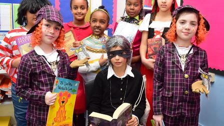 Children from Kingsmead Primary School celebrate World Book Day in costume on 01.03.18. including tw