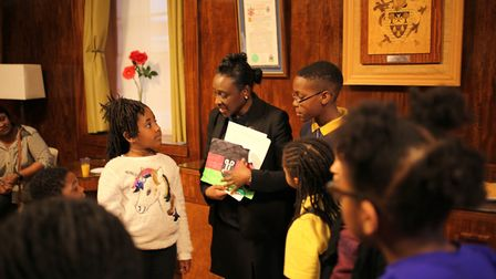 Young artists explaining the reasons for their designs to Deputy Mayor Antoinette Bramble. Picture: