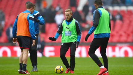 Huddersfield Town's Alex Pritchard (centre) warms up ahead of the Premier League match at Wembley St