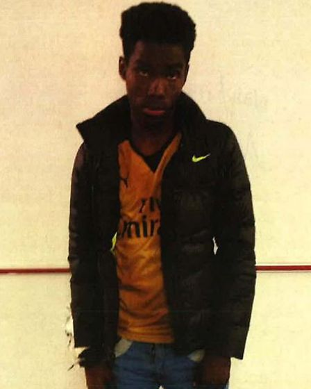 Derryck John in custody wearing his distinctive trainers and jeans which helped identify him