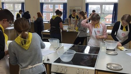 Polish students from Mielec, Poland, take part in a Food Technology lesson at Ormiston Denes Academ
