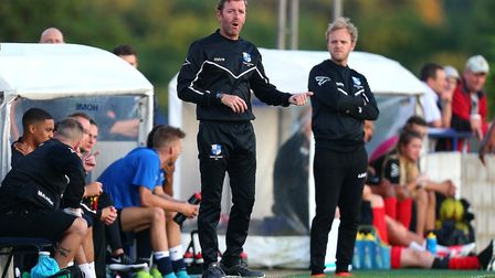Wingate & Finchley manager Keith Rowland (left) gives instructions from the touchline alongside assi