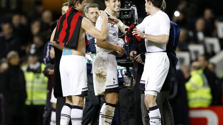 Tottenham Hotspur's (left) Roman Pavlyuchenko, Michael Dawson (centre) and Gareth Bale celebrate win