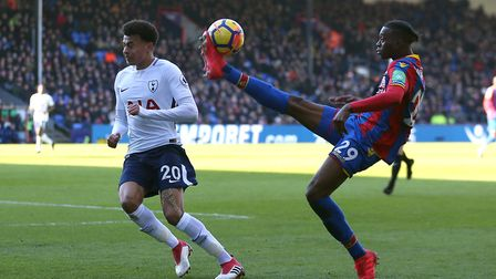 Tottenham Hotspur's Dele Alli (left) and Crystal Palace's Aaron Wan-Bissaka battle for the ball duri