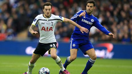Tottenham Hotspur's Ryan Mason battles for the ball with Chelsea's Cesc Fabregas in the final of the