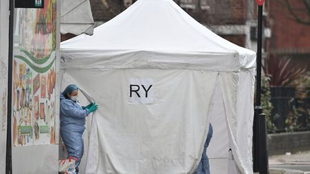 Police forensics at the scene in Bartholomew Road last week. Picture: Dominic Lipinski/PA Wire