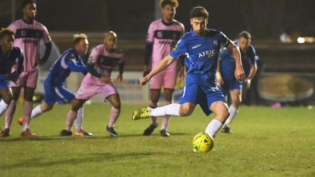 Captain Travis Cole scores a 90th minute penalty for Lowestoft Town. Picture: Nick Butcher