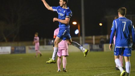 Travis Cole celebrates after slotting in a penalty in the final minute. Picture: Nick Butcher