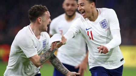 Tottenham's Kieran Trippier (left) celebrates with England matchwinner Jesse Lingard at the Amsterda