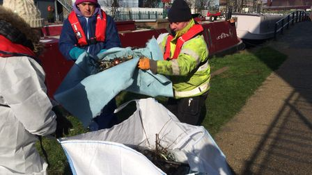 Volunteers help out with the clean-up operation following the River Lea oil spill. Picture: Canal an