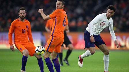 Holland's Davy Propper and Stefan de Vrij look on with Tottenham and England's Dele Alli during the