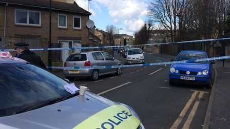 Police have taped off Ferncliff Road in Dalston following last night's shooting. Picture: Emma Barth