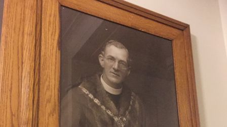 A portrait of former Hackney mayor Rev W Evans, who tried to ban the women's boxing match, hangs on
