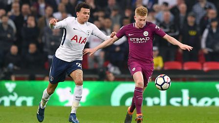 Tottenham Hotspur's Dele Alli (left) and Manchester City's Kevin De Bruyne battle for the ball durin