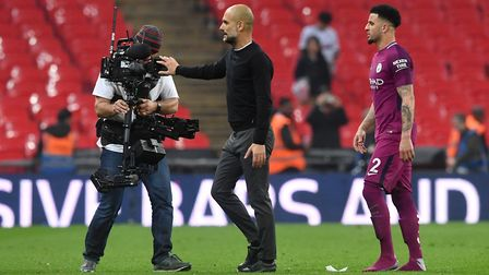 Manchester City manager Pep Guardiola and Kyle Walker after the final whistle of the Premier League