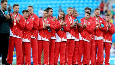The England Men's Rugby team, including Saracens wing Mike Ellery, celebrate winning bronze in the M
