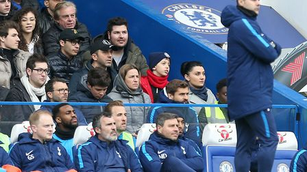 Tottenham Hotspur's Harry Kane on the bench behind manager Mauricio Pochettino during the Premier Le