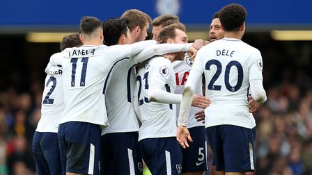 Tottenham Hotspur's Christian Eriksen (centre) celebrates scoring his side's first goal of the game