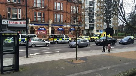 Police at the scene in Upper Clapton Road. Picture: @999London