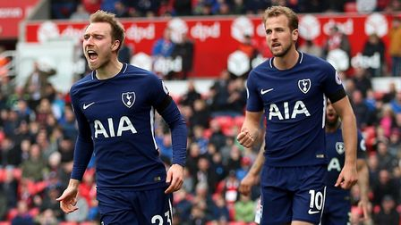 Tottenham Hotspur's Christian Eriksen celebrates scoring his side's first goal at Stoke with Harry K