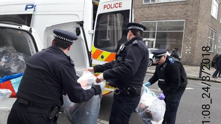 Police taking away the bags. Picture: Hackney Council