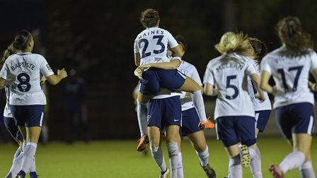 Coral-Jade Haines is hugged by a Tottenham Hotspur Ladies team-mate after scoring a late penalty win