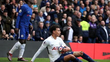 Tottenham Hotspur's Dele Alli (right) reacts to a challenge from Chelsea's N'Golo Kante during the P
