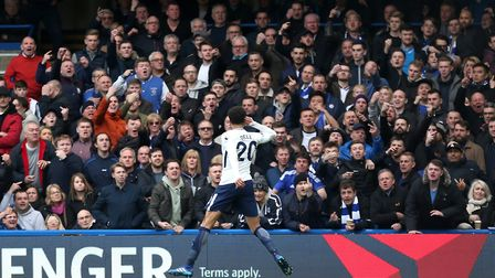 Tottenham Hotspur's Dele Alli celebrates scoring his side's second goal of the game in front of Chel