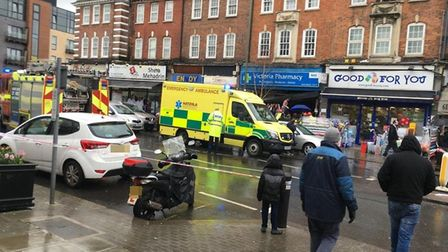 Ambulance rushed to the scene after a car hit two pedestrians as it mounted the pavement and ploughe