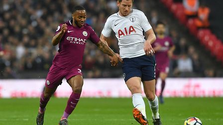 Manchester City's Raheem Sterling (left) and Tottenham Hotspur's Jan Vertonghen battle for the ball